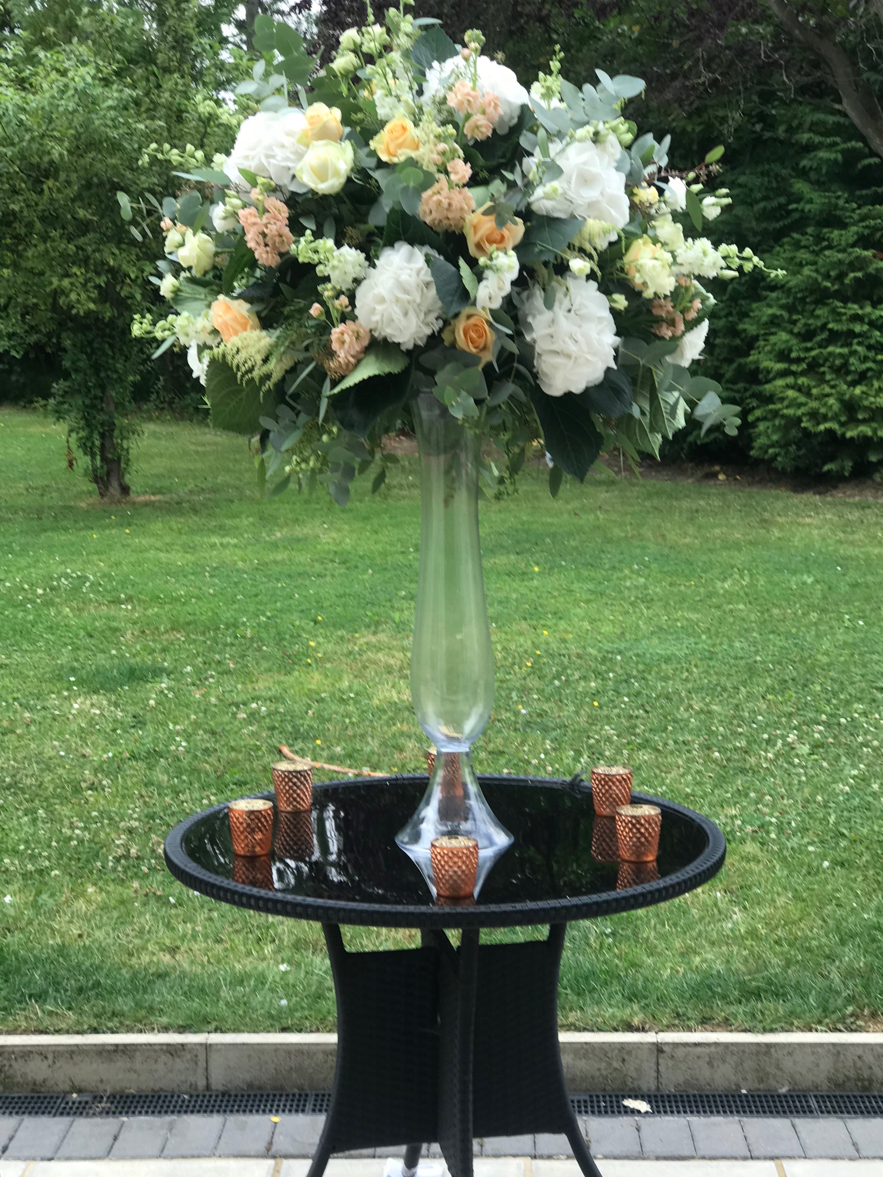 copper tea light holders tall glass vases wedding centrepieces