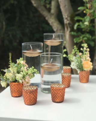 copper wedding centrepieces cylinder vases floating candles