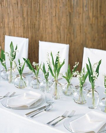 glass bud vases along table wedding styling