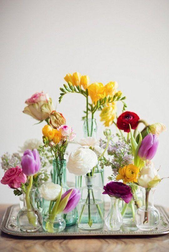 bright bud vases on tray wedding styling