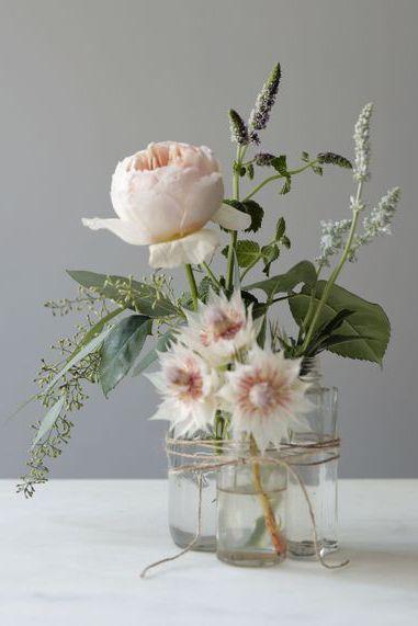 blush pink flowers in bottle vases