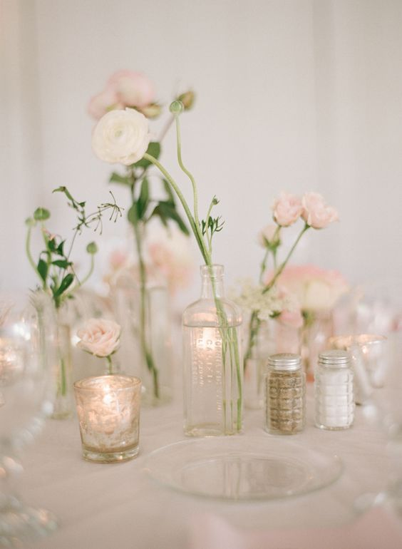 gorgeous-wedding-centrepiece-single-stem-ranunculus-in-glass-bud-vases
