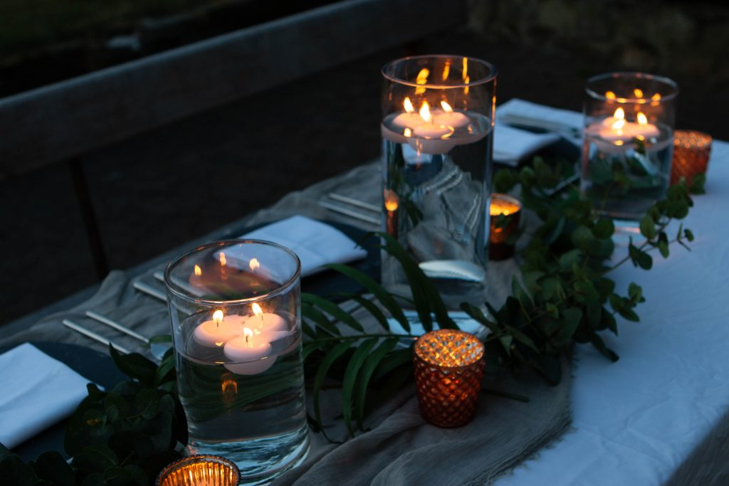 grey and copper wedding styling centrepieces copper tea lights grey table runners autumn wedding ideas