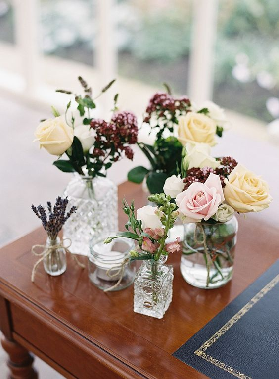 mix of glass vases for wedding centrepieces and styling ideas