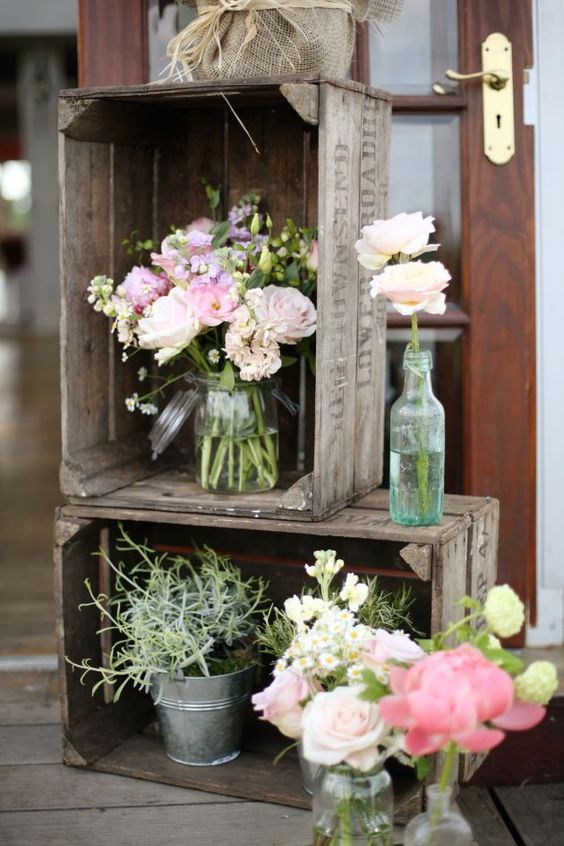rustic wedding styling ideas crates with bud vases of flowers