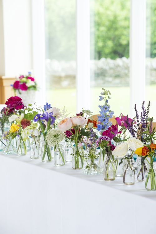top table wedding ideas bud vases bright flowers