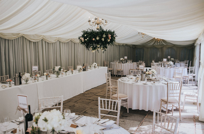 Hanging flower hoops in marquee wedding venues Birtsmorton Court