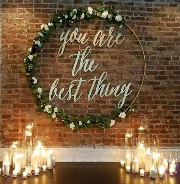 barn wedding backdrop hoop with lanterns