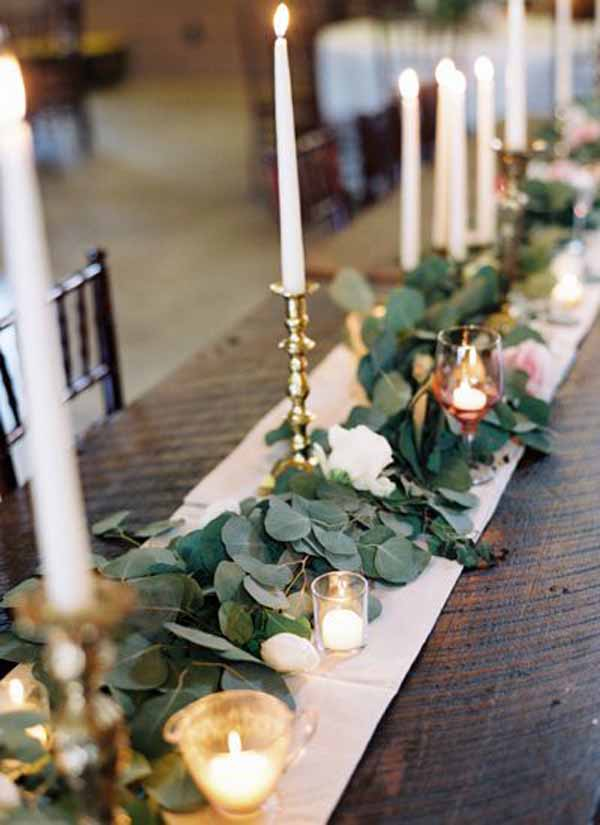 barn wedding foliage garlands with gold candlesticks