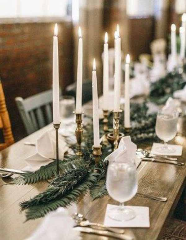 barn wedding gold candlestcks foliage garlands along tables
