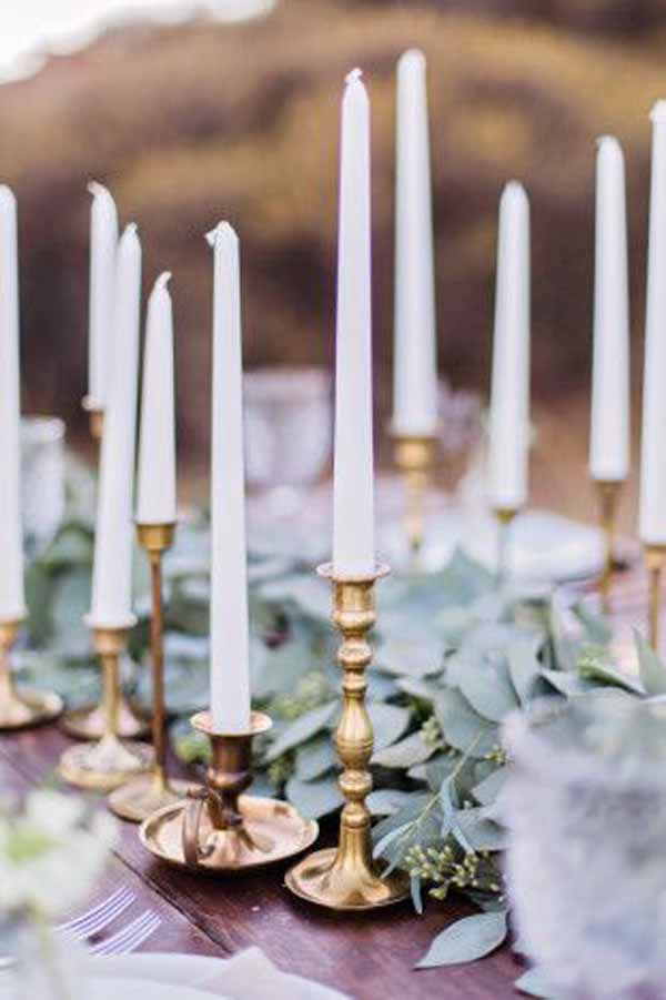 barn wedding gold candlesticks with foliage garlands