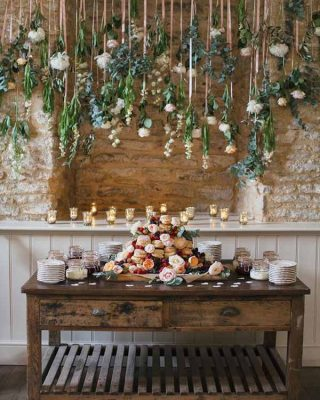barn wedding hanging flowers installation