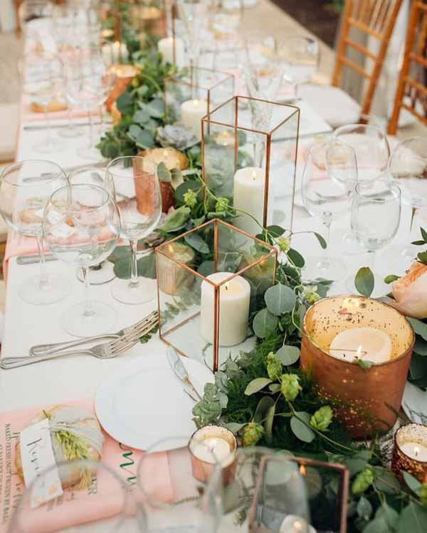 barn wedding with brass lanterns and foliage garlands