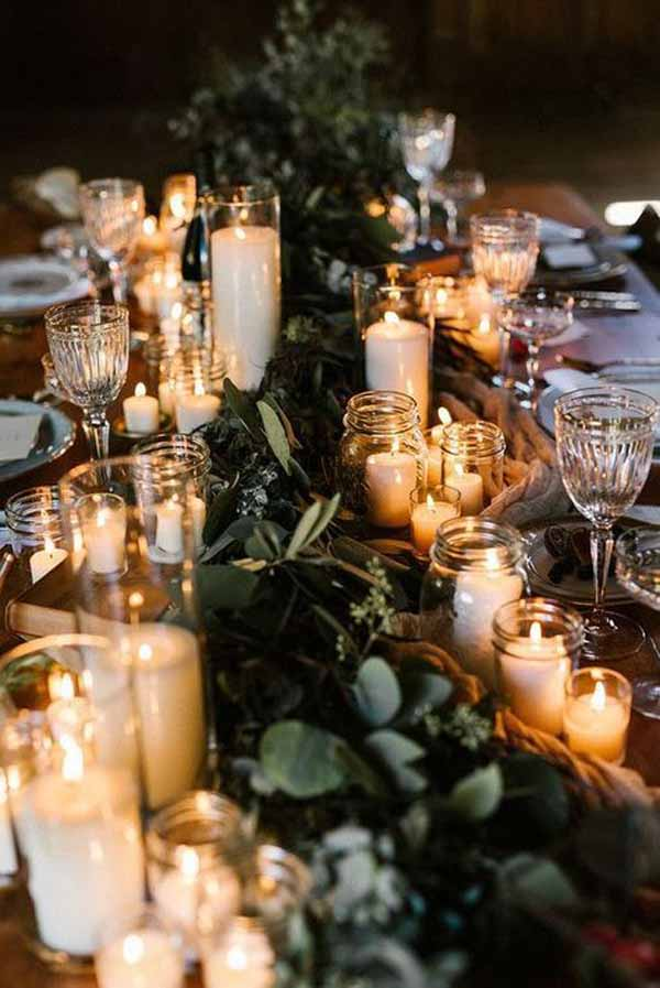 barn wedding with foliage garlands and lanterns
