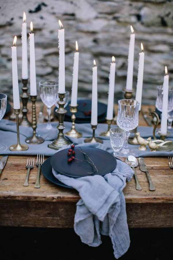 barn wedding with gold candlesticks and grey table runners