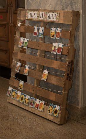 peg photos onto a wooden pallet wedding ideas