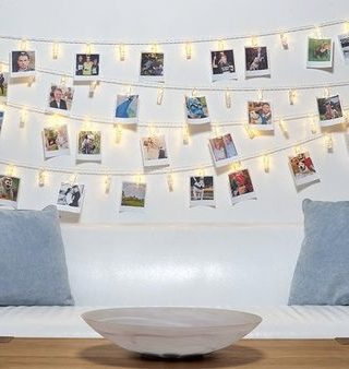 wedding ideas peg up photos around your venue