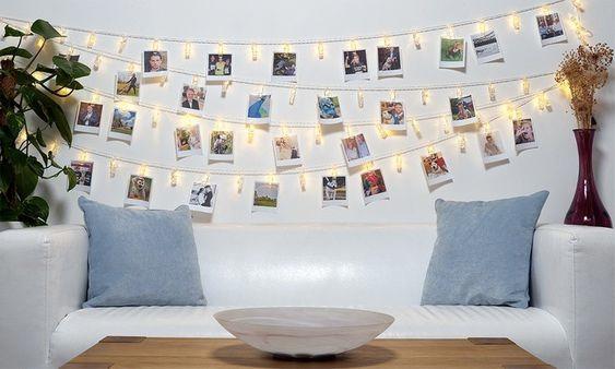 wedding ideas peg up photos around your venue