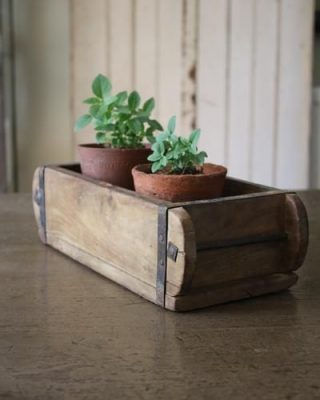 brick mould with potted plants wedding centrepiece