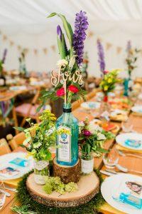 gin bottle vases wedding centrepiece wild flower marquee wedding ideas