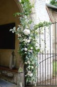 green foliage church entrance wedding flowers