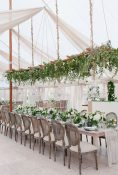 green foliage hanging wedding flowers above table