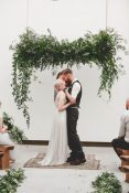 hanging wedding ceremony frame backdrop foliage greenery