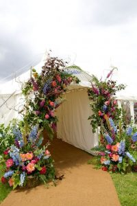 marquee arch entrance of wild flowers