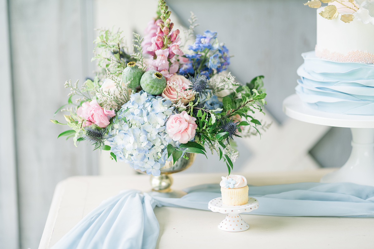 summer barn wedding blue cake table with gold footed bowl wedding flowers centrepieces 2