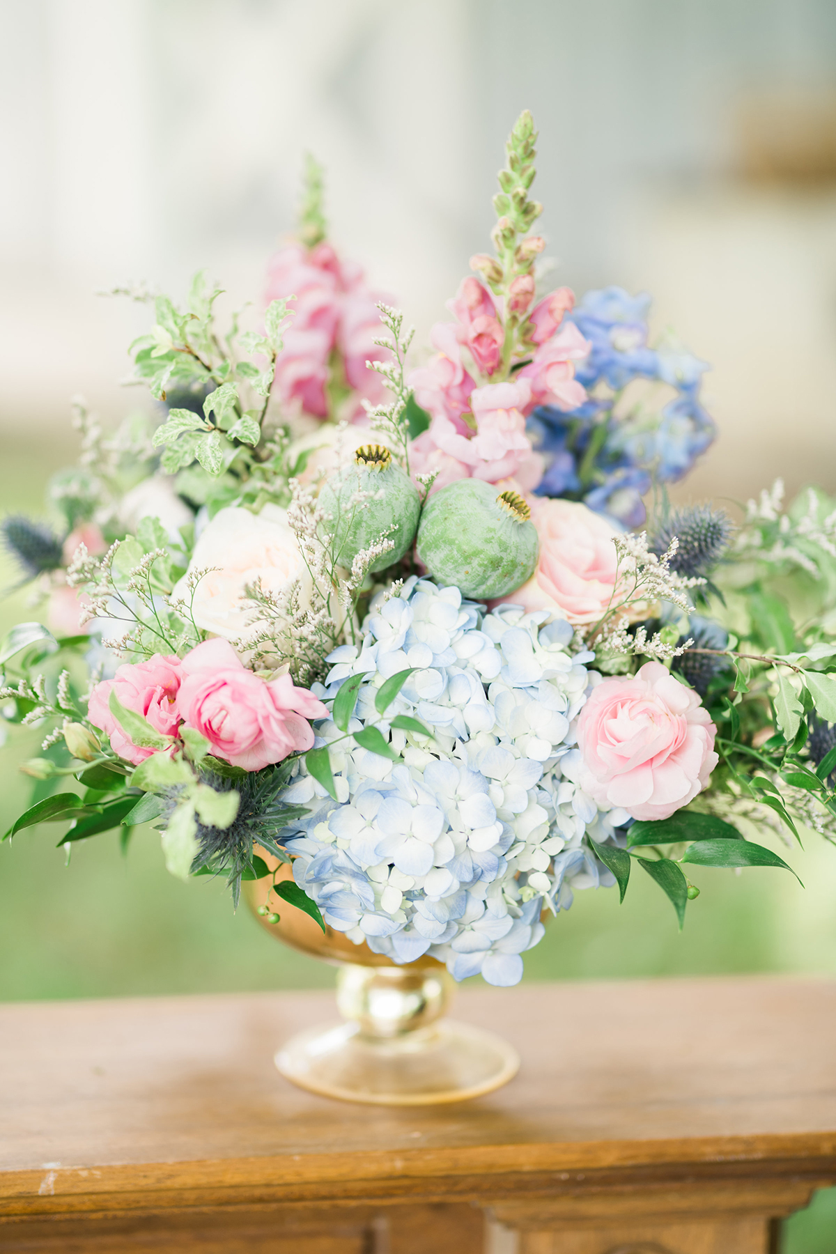 summer wedding centrepieces blue pastel flowers in gold footed bowl centrepieces