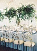 tall gold floral stands foliage green wedding