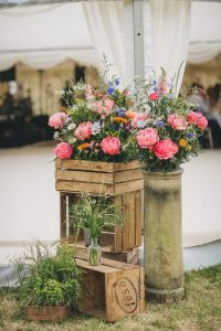wildflowers entrance to marquees in wooden crates