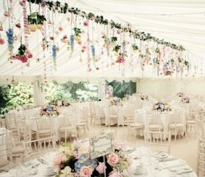 wildflowers hanging from marquee wedding styling