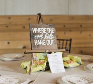 Kids table wedding centrepiece ideas sign where the cool kids hang out