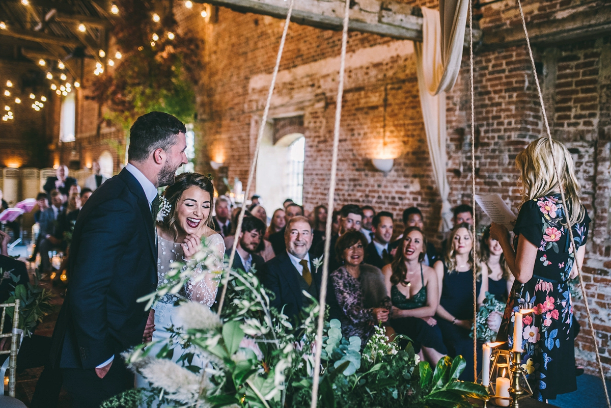 Barn wedding ceremony foliage and candles