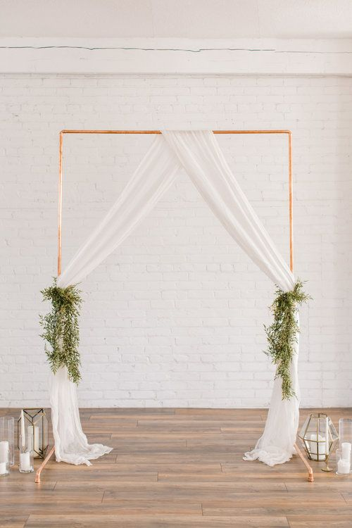 wedding backdrops copper arch drapes and foliage