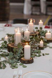 eucalyptus garlands wedding tables rustic wedding log slices