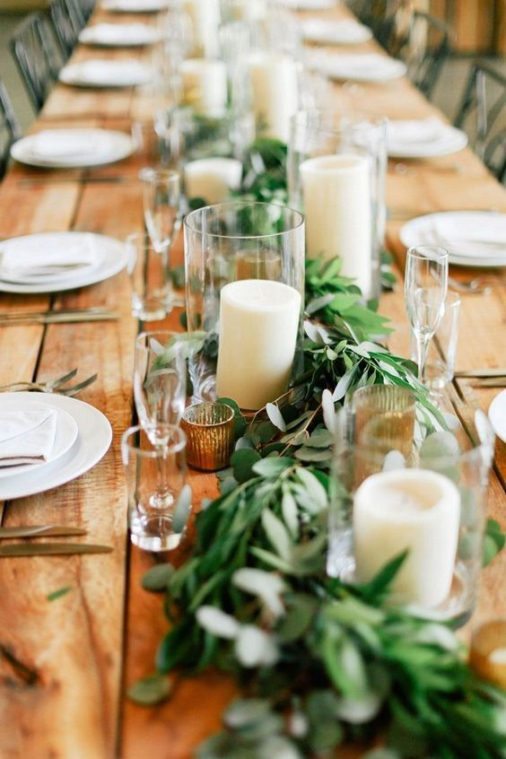 eucalyptus garlands with cylinder vases candles wedding tables