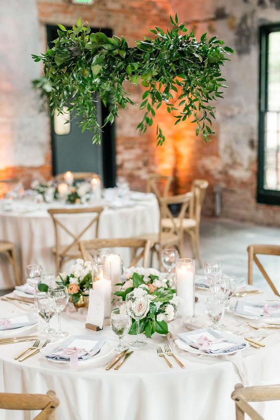 hanging hoops suspended over wedding table centrepieces
