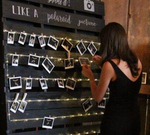 barn wedding photo display on pallets